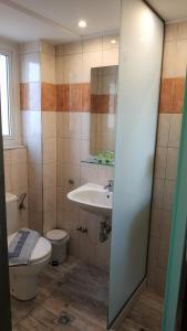 Ένα μπάνιο στο Ξενοδοχείο Ναυσικά