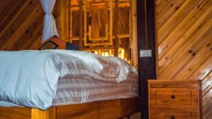 Giường trong phòng chung tại Chô Family