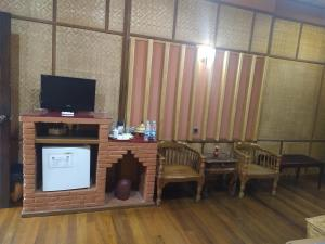 A television and/or entertainment center at Kaday Aung Hotel