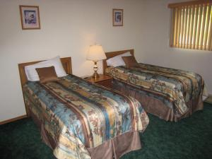 A bed or beds in a room at Fairmont Villas Mountainside