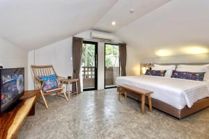 A bed or beds in a room at Deevana Krabi Resort - Adults Only