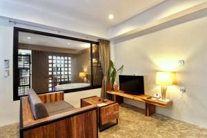 A television and/or entertainment center at Deevana Krabi Resort - Adults Only