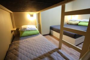 A bed or beds in a room at Sky Island Guesthouse
