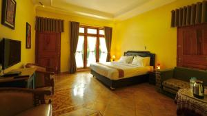 A bed or beds in a room at Rumah Desa Homestay