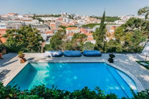 The swimming pool at or close to Torel Palace Lisbon