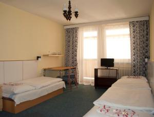 A bed or beds in a room at Garni G Hotel Bratislava