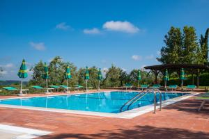The swimming pool at or near Borgo Di Collelungo