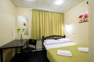 Кровать или кровати в номере Мини-отель Соколиная Гора