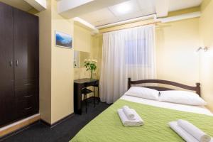 Кровать или кровати в номере Мини Отель Авиамоторная