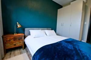 A bed or beds in a room at Faanbergh Accommodation