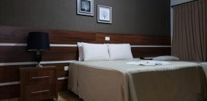 A bed or beds in a room at Hotel e Restaurante Canta Galo