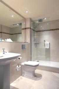 A bathroom at Macdonald Craxton Wood Hotel & Spa