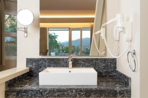 Salle de bains dans l'établissement Art Hotel Debono