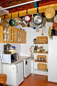 A kitchen or kitchenette at Nádas Fogadó