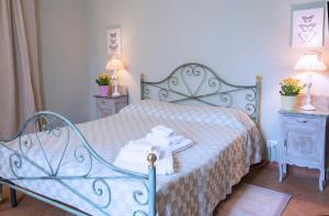 Letto o letti in una camera di Agriturismo Cascina Olivetta