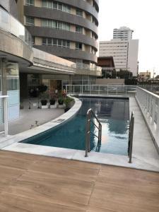 The swimming pool at or close to Apto 2/4 Frente Mar em Ponta Negra