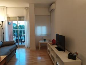 A television and/or entertainment center at Aguila 110