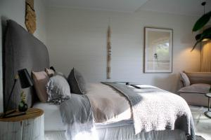 A bed or beds in a room at 28 Degrees Byron Bay - Adults Only