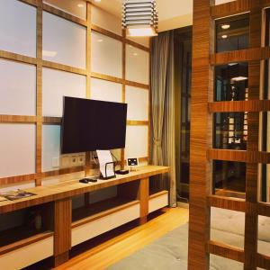 A television and/or entertainment centre at Apartment Taman Anggrek Residence 2BR