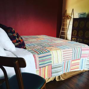 A bed or beds in a room at Breadfruit B&B