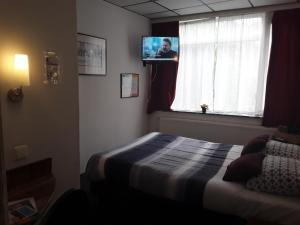 Een bed of bedden in een kamer bij Hotel Baan