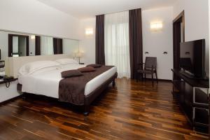 TV o dispositivi per l'intrattenimento presso Best Western Hotel Biri