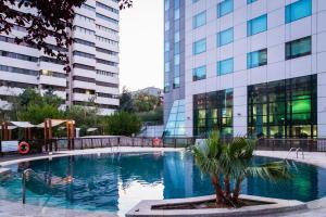 The swimming pool at or near Eurostars Suites Mirasierra