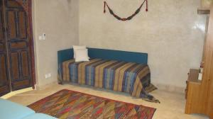 A bed or beds in a room at Dar Kamango