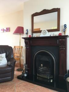 A television and/or entertainment center at Castleview Holiday Home