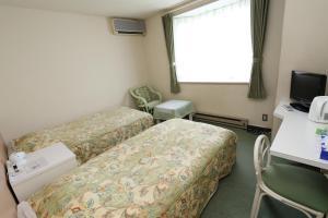 ガストホフ メラージにあるベッド