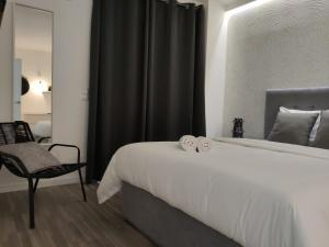 A bed or beds in a room at Apartments City Center • Collection by Perpetual Relax