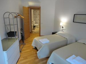 Łóżko lub łóżka w pokoju w obiekcie Residencial Suites Valldemossa - Turismo de Interior