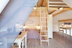A bunk bed or bunk beds in a room at Charming Slovenia - Herbal Glamping Resort Ljubno