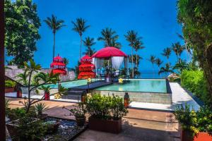 The swimming pool at or near Kupu Kupu Phangan Beach Villas & Spa by L'Occitane