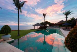 The swimming pool at or near The Ungasan Clifftop Resort