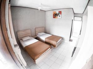 Ein Bett oder Betten in einem Zimmer der Unterkunft Palm Garden Kuta