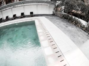 Der Swimmingpool an oder in der Nähe von Palm Garden Kuta