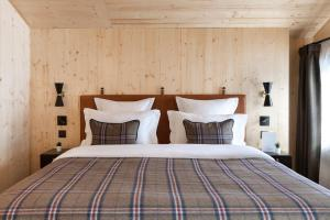 A bed or beds in a room at St-Alban Hotel & Spa