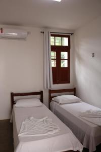 A bed or beds in a room at Pousada Convento da Conceição