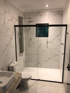 Um banheiro em Resort Magnifico