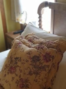 A bed or beds in a room at La Casina de Terobe