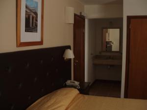 Una cama o camas en una habitación de Montecassino
