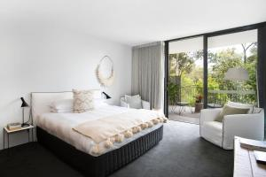 A bed or beds in a room at Bannisters Pavilion Mollymook