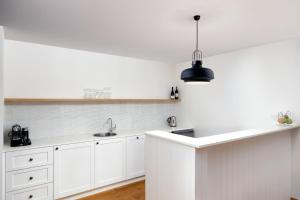 A kitchen or kitchenette at Bannisters Pavilion Mollymook