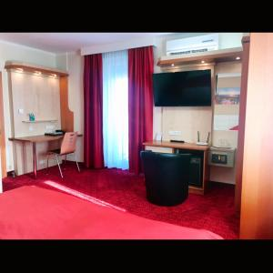 A kitchen or kitchenette at Hotel Aragia