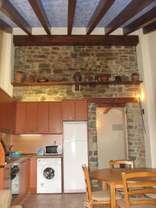 Una cocina o zona de cocina en Apartamentos Russell
