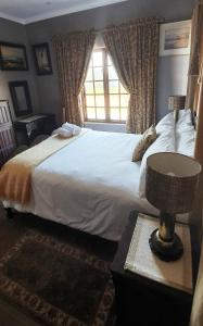 A bed or beds in a room at aHa Guest House