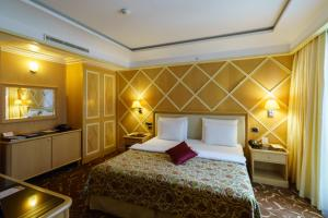 A bed or beds in a room at Splendid Conference & Spa Resort