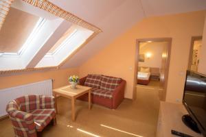 Ein Sitzbereich in der Unterkunft Landhaus & Landhof Gabriel