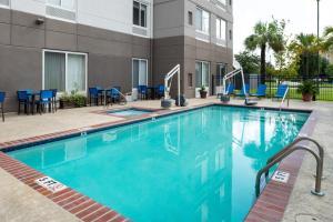 The swimming pool at or near Hilton Garden Inn Baton Rouge Airport